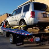 SUV On Tow Truck Back